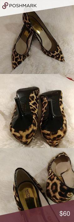 Michael Kors kitten heel leopard shoes Authentic Michael Kors leopard heels kitten  wore twice . They are like new.   NO BOX Michael Kors Shoes Heels