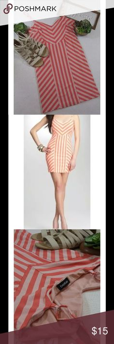 """bebe Annie striped dress L Brand - bebe Size - Large Color - a light coral and dark coral Material - 100% Polyester Style - ANNIE LCQ RN 86017 Casual/Party/Weekend Adjustable straps to allow for longer/shorter length (like a bra) Fully Lined Length - 25"""" (measured at V neckline to bottom of hem of garment) Waist - 30"""" (measured at tie area and doubled) Pit to Pit - 34""""  Excellent used condition. No stains, rips or tears. All measurements are approximate. bebe Dresses Mini"""