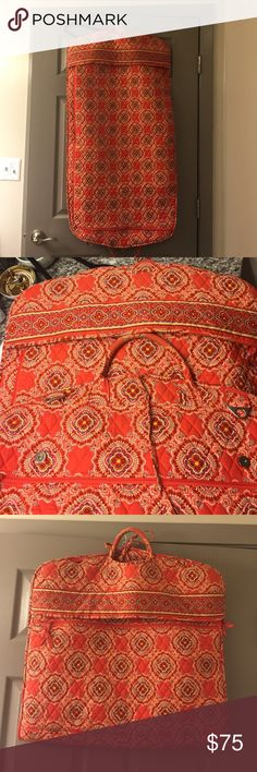 Vera Bradley garment bag Great condition! One small mark shown in picture 4 and slight darkening/signs of use of handle but no other flaws detected. This bag was only gently used. Hold A LOT!!!!! Vera Bradley Bags