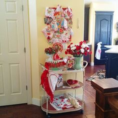 Valentine's Day count down . . . my view coming down the hallway each morning. Mr. gifted me the tea cart from @tuesdaymorning for Christmas. I miss my antique ladies writing desk in that space, but love the extra shelves! ❤ #TuesdayMorning
