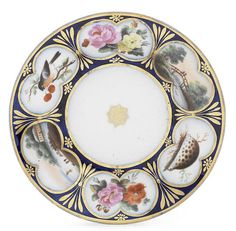 An important Coalport saucer dish from the Lewes service, circa 1812 Painted by Thomas Pardoe in Bristol in 1812 in his distinctive style with six lobed panels of shells, flowers, landscapes and a brightly coloured bird perched on a branch, reserved on a deep blue ground gilded with neoclassical decoration, a Garter Star in the centre, 21.5cm diam, inscribed inside the footrim in gold 'Pardoe 28 Bath St Bristol' in Pardoe's distinctive hand