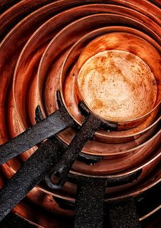 Buy 'Copper Pans' by Simon Duckworth as a Greeting Card. These wonderful copper pans were for sale at our local village antique fair, slight crop and processed in to bring out colour and depth.