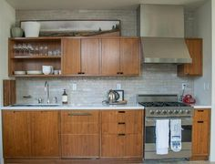 LOVE this kitchen. Retro feel but not literally retro, open shelving but not too much, sink far enough from stove to leave open workspace, tile above cabinets makes it seem purposeful instead of just blank space...