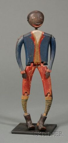 Articulated Carved and Painted Wooden Figure of a Black Man, America, 19th century, including stand, overall ht. 12 in.