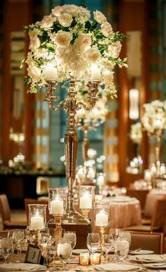 Romantic table decor with tall centrepieces