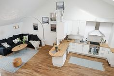 Scandinavian Duplex Harmonizing Coziness and Elegance in Gothenburg  Read more: http://freshome.com#ixzz3XruFSX5N Follow us: @freshome on Twitter | freshome on Facebook