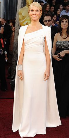 Academy Awards 2012, Gweneth Paltrow, wearing Tom Ford. Not everyone can wear a white dress that's THAT tight, but Gweneth can! Well done! (But you're not super-grover, take the cape off, and actually do your hair!)