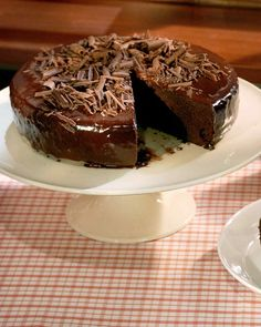 If the sides aren't perfectly glazed, press in chocolate shavings for an easy cover-up.