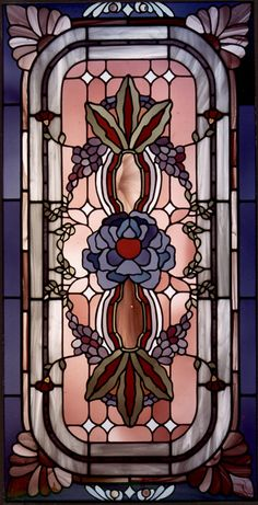 Love the colors in this stained glass piece...might be a way to save my burgundy dining room and tie it in with my slate blue kitchen cabinets.