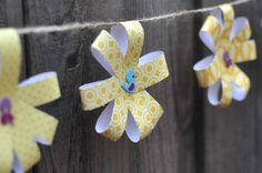 Wedding shower decor -- love this garland!! I can do this! ... could make paper crowns or Minnie Mouse bows