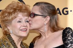 Carrie Fisher Photos Photos - Actresses Debbie Reynolds (L), recipient of the Screen Actors Guild Life Achievement Award, and Carrie Fisher pose in the press room at the 21st Annual Screen Actors Guild Awards at The Shrine Auditorium on January 25, 2015 in Los Angeles, California. - 21st Annual Screen Actors Guild Awards - Press Room