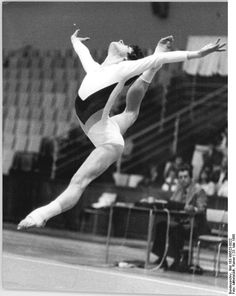 Gymnast Regina Grabolle performing stag leap on floor exercise (1980).