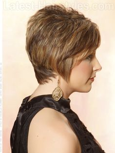 FEATHERED PIXIE The amazing caramel highlights added to this pixie create a texture explosion! Soft side bangs are contrasted with edge shattered pieces throughout the entire haircut. Longer side burns hug the face in a very flattering way and keep the cut feminine.