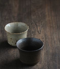 Teacup  Brand: Sfera Made in Japan  A young potter from the Bizen area produces these thin, lightweight cups for Sfera in an ash glaze and black glaze finish. Well designed and comfortable to hold, the delicate thin lip of the cup make them a pleasure to drink from. The ash glaze finish has glasslike characteristic while the black glaze has spare muted tone that ranges from brown to near black.