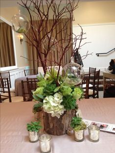 An arrangement of succulents & green flowers also using clear glass ornaments Succulent Centerpieces, Floral Centerpieces, Table Centerpieces, Wedding Centerpieces, Wedding Table, Wedding Decorations, Table Decorations, Decor Wedding, Rustic Wedding