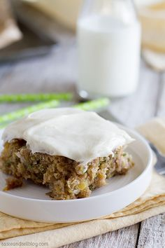 This zucchini cake gets a twist with pineapple and coconut that go throughout, making a cake that is moist and addictive. It is topped off with a silky cream cheese frosting.