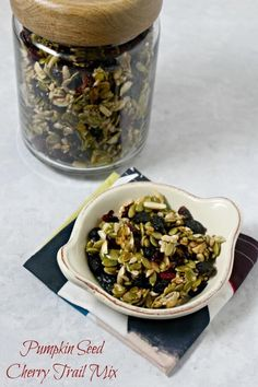 This Pumpkin Seed Cherry Trail Mix is way more addictive than pistachios. Pumpkin seeds and nuts tossed with dried cherries and cranberries with a touch of sweetness - it's a snack you can feel good about | Cooking In Stilettos