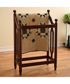 @Overstock - A classic quilt/blanket rack is the perfect combination of style and function  Display your precious heirloom quilt and blanks while adding elegance and style to your room  Holder comes in a cherry finishhttp://www.overstock.com/Home-Garden/Classic-Cherry-Blanket-Quilt-Rack/2545239/product.html?CID=214117 $49.99