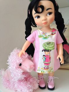 Happiness is a new pink dress and doggie  Dress by Sherbet Lemoni for.  Disney animator collection doll  Keep checking my Etsy shop for new creations. Sherbet Lemoni