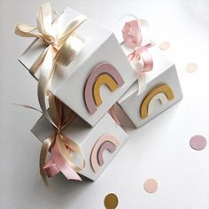 Looking for Baby Shower or 1st Birthday decorations?! Boho Rainbow favor boxes make your party adorable and perfect for small gifts. --COLOR--• Dusty pink, Ivory, Blush, Mustard, White-- DETAILS--• Boxes made of heavyweight paper• Size: 2,95x2.95x2.95 inches• Quantity: 12pcs of boxes in 1 pack• Designed with boho rainbow in front and two pieces of ribbon• Boxes ship flat, simple assembly required (no gluing)• Ribbons: orange, green and ivory pre-cut in 27 inches lengths (not attached to the box) 1st Birthday Party Decorations, Girl Birthday Themes, Baby Girl First Birthday, 1st Birthday Parties, Rainbow Theme Baby Shower, Rainbow Birthday Party, Baby Shower Themes, Boho Baby Shower, Baby Shower Fall