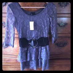 ❗️!!NEW!!❗️Ladies gorgeous shimmer ruffled blouse! ❗️!!NEW!!❗️ Ladies gorgeous shimmer ruffled blouse!  Sheer lace sleeves. Comes with belt. Never worn, new with tags! ❣ Rue 21 Tops Blouses