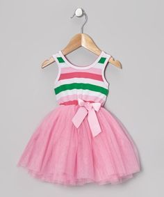 This high-quality dress has a prim bow and multiple layers of soft tulle covering its stretchy striped lining. Party-perfect and designed to pull on, it captures a little girl's idea of upscale style without skimping on comfort.