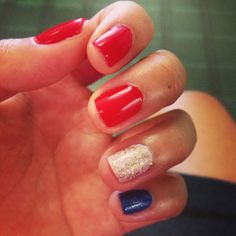 July 4th nail art.  Red White and Blue, then top the white with chunky gold glitter and and the blue with fine silver glitter polishes.