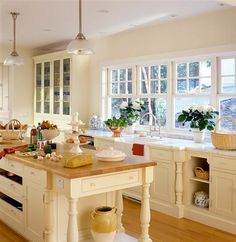 Love the warm feeling of this kitchen and I can imagine the breezes from the lineup of windows.