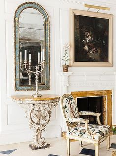 "The pair of verre églomisé—French for ""gilded glass""—mirrors reinforce the light-filled atmosphere of this room."