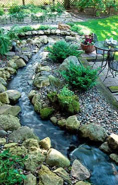 Backyard rock and stream landscaping • photo: The Green Living Expert