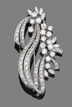 A diamond spray brooch  Of abstract design, set throughout with brilliant, single and marquise-cut diamonds, diamonds approx. 5.80cts total, length 5.8cm