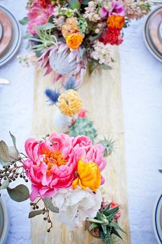 : Primary Petals: mix of peonies, king protea, blue thistles, air plants, ranunculus + more