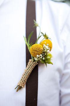 Groomsmen flowers on teal of dark brown suspenders
