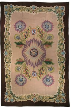 A Hooked rug BB1146 - by Doris Leslie Blau. A mid 20th century hooked rug, the ivory field with an overblown lilac flowerhead center radiating playful flowers ...