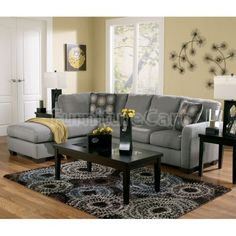 With a comfortable contemporary design, the Zella-Charcoal Sectional Set by Signature Design by Ashley Furniture takes the comfort of plush cushions and soft upholstery fabric and creates a sleek style with the shaped arms subtle gray-toned upholstery that enhances the decor of any home.