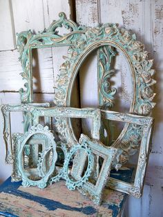 Aqua white ornate frame grouping, vintage antique mix distressed Baroque gesso styles Anita Spero.