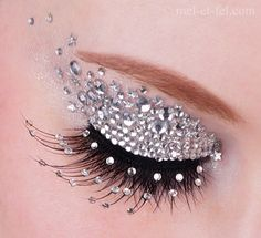 Beautifully executed rhinestone eye make-up complete with crystal accented eye lashes.