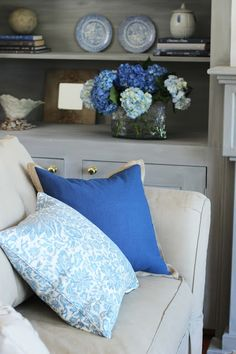 Repeating colors. That is the basics of home decorating, take a color and sprinkle it around. The perfect vehicle for color spreading are pillows and flowers.  Instant results.  Find  incredible pillows at HomeGoods like I do. Sponsored pin.