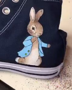 Time lapse video of the Peter Rabbit design being painted onto Navy high top Converse trainers. Custom Painted Shoes, Painted Canvas Shoes, Painted Clothes, Custom Shoes, Converse Sneaker, Converse Trainers, Peter Rabbit, Painted Converse, Diy Clothes And Shoes