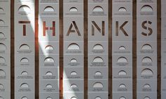 The A.C.T's donor wall is as understated as it is artful. The half-moon cut-outs vary in size according to contribution levels, and reference the A.C.T. word mark.