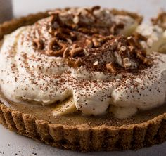 This banoffee pie is the perfect family treat. This much-loved combination of caramel, bananas and cream is served on a delicious crunchy biscuit base and sprinkled with chocolate. We've added a delicious twist with a hit of coffee in the caramel and some salted pretzels for extra crunch factor.
