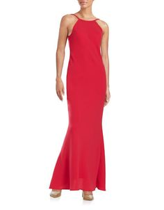 A scoop back lends an alluring finish to this elegant halter gown.