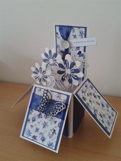Floral pop up box card in blue with a die-cut butterfly.