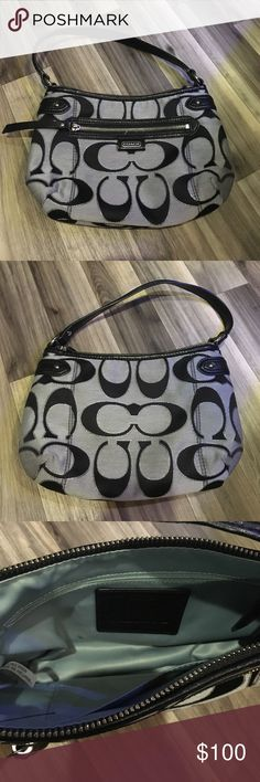 """NWOT! Black and Silver Coach Purse! This has been carried one time and stored. It is in excellent condition with a small mascara smudge inside as shown that could easily be removed. Inside is a light blue color, authentication tag as shown, and has an outside zipper pocket. Measures approx. 10 1/2"""" wide and 7"""" deep. Coach Bags Hobos"""