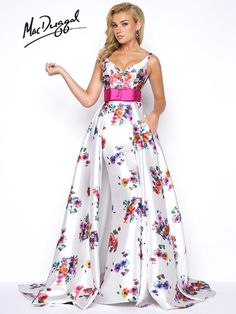 Floral print, off the shoulder, sweetheart neckline, mermaid satin prom dress with overskirt and belted bow waistline.