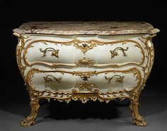 1765 German (Fraconia) Commode at the Metropolitan Museum of Art, New York - This piece showcases the soft curved lines, naturally-inspired scroll-work, and light colours of the Rococo aesthetic.