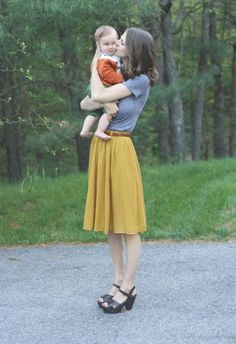 I say I just love the mustard skirt, but I actually also love the grey top and shoes. And of course, the baby.