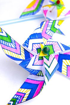 Easy kids paper crafts: Decorate and make your own op-art pinwheels. Template included in post.