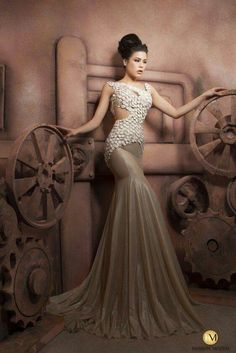 Couture evening dresses can be recreated as a custom wedding gown by our dress design firm. Get replicas made too at www.dariuscordell.com