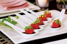strawberry in chocolate sauce on Japanese soup spoons